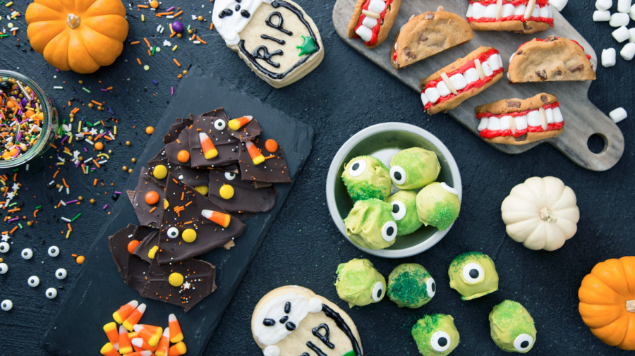 An array of extravagant Halloween snacks ready to be eaten. Halloween is the perfect occasion to bake using new, festive, recipes.