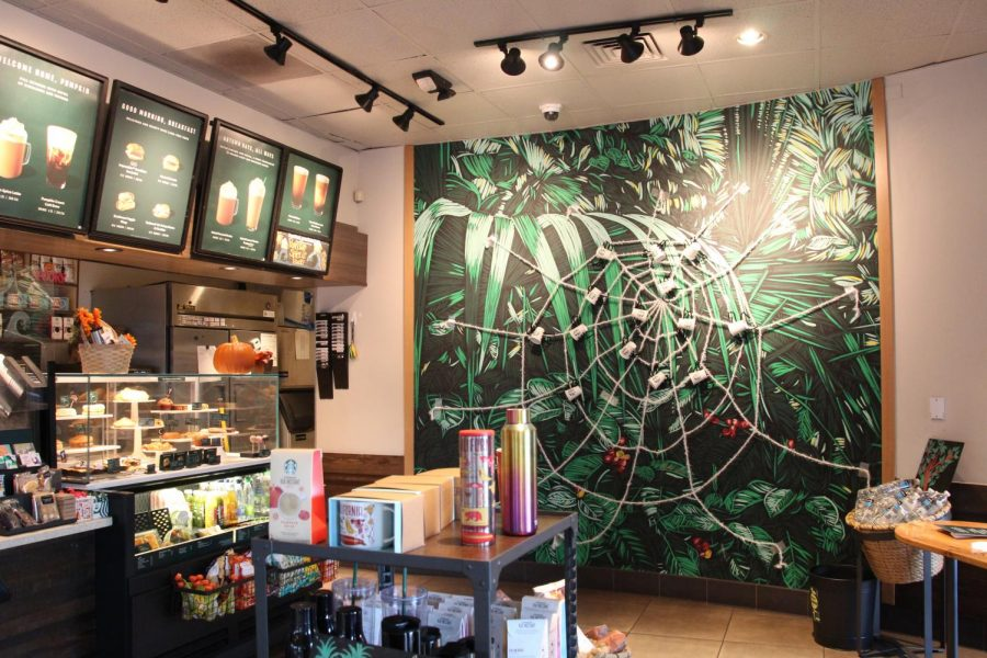 The village Starbucks Coffee Shop is all decked out for Halloween with custom, homemade decorations. Customers enjoyed their drinks as well as the fantastical decorations.