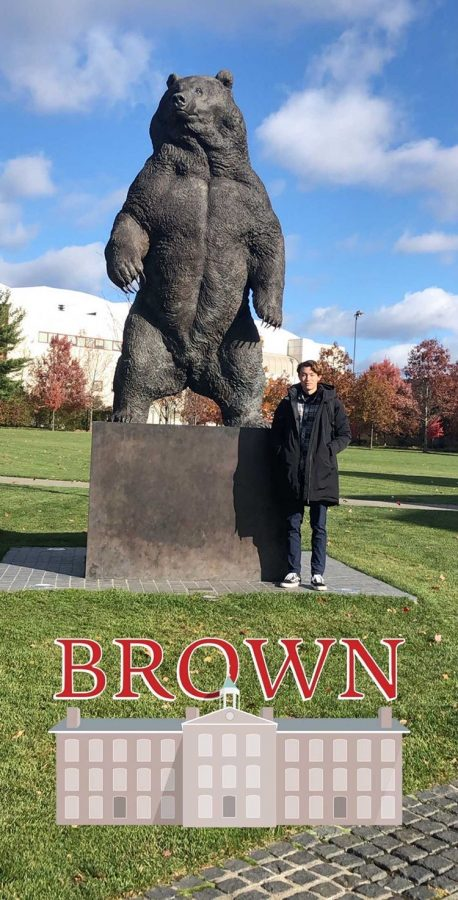 """Nathan Brasher stands for a photo with a statue of the Brown University mascot, the Bear, while visiting their campus in Rhode Island. Players were recruited from across the country to play for the prestigious school. """"I luckily got to meet one of my teammates [and] he lives in Washington,"""" Brasher said. """"At another tournament, I got to see one of my teammates who's from Georgia, [but] we [also] have one [player] from Texas, Florida, and a couple from California besides [myself]."""""""