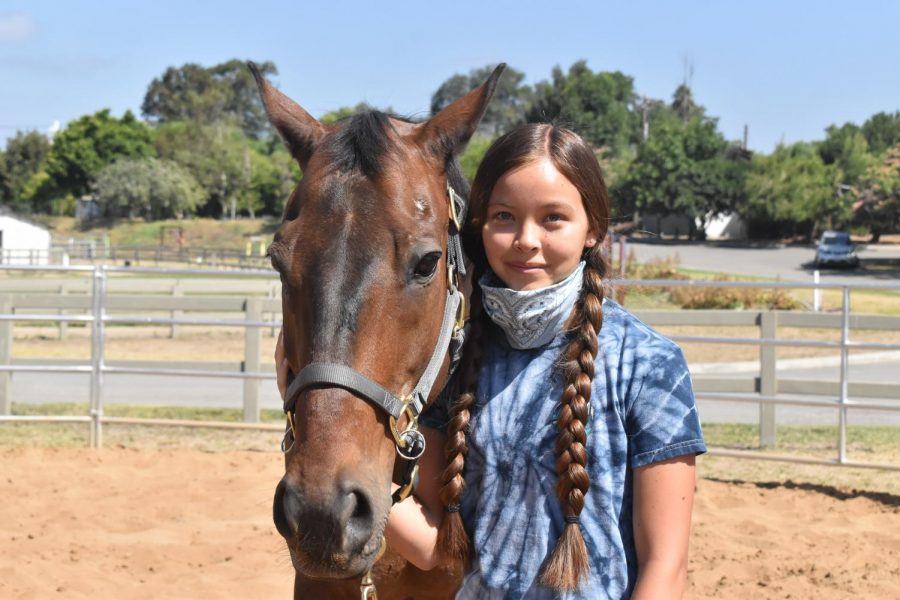 Jade Chen 16 Year Old junior she is a volunteer at Ivey Ranch she is together with a horse and that's what she does at Ivey Ranch.