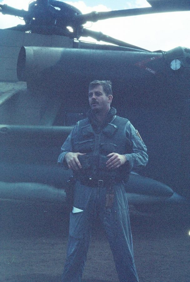 Jones stands in front of his helicopter. Jones served in the military for 20 years.
