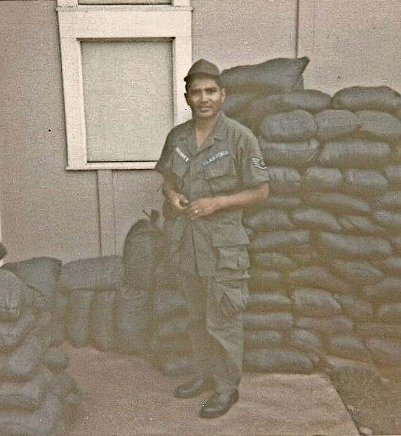 Vasquez stands at base in Vietnam during his deployment. Vasquez served for 20 years from 1957-1977.