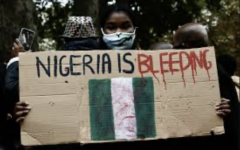 Nigerians protest against the SARS police force in Nigeria. These protests have been going on for months, but have recently been spurred by a video of a SARS officer shooting an innocent man.