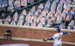 New York Met second basemen, Robinson Canó plays caught before a game without any fans in attendance. For the first time in MLB history, no fans were allowed for the entire 2020 MLB season due to the Covid-19 pandemic, although fans could purchase cardboard cut-out pictures of themselves to be put in certain seats at their desired stadiums.