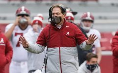 Alabama head coach Nick Saban strolls the sideline during the Crimson Tide's 52-3 blowout of Arkansas. Alabama has embarrassed most of the teams on their schedule this year however, Alabama will face better competition in the CFP.
