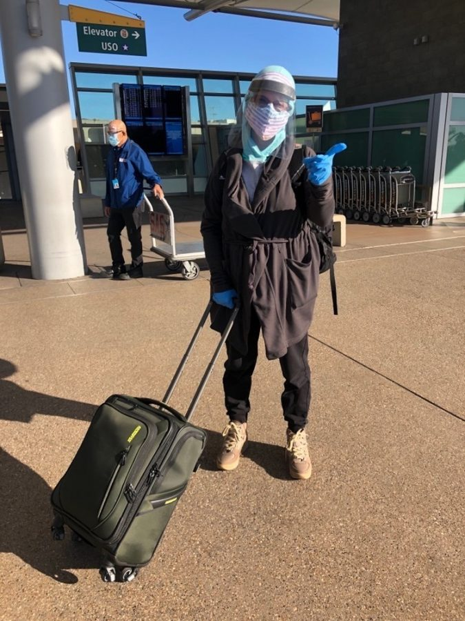 A Carlsbad nurse prepares to fly to Texas. In the era of COVID-19, many who choose to fly out of state take extra safety precautions.