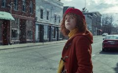 Lucy, the main character, stands outside as it snows. A thought-provoking psychological horror film,
