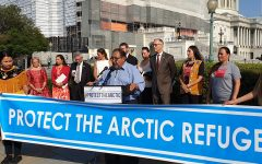 Members of Congress and members of the Gwich'in stand in solidarity against oil drilling in the Arctic Wildlife Refuge.