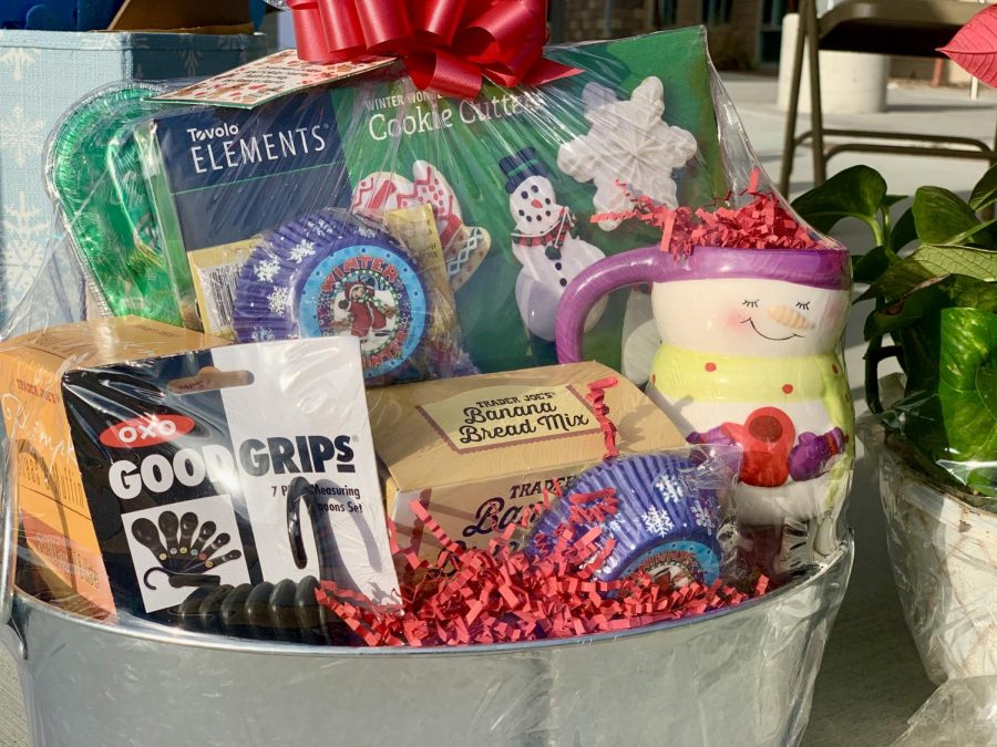 Snowmen cups, baking essentials, and bread mixes fill the basket. This is one of the baskets that were up for raffle for the teachers and staff of Sage Creek.