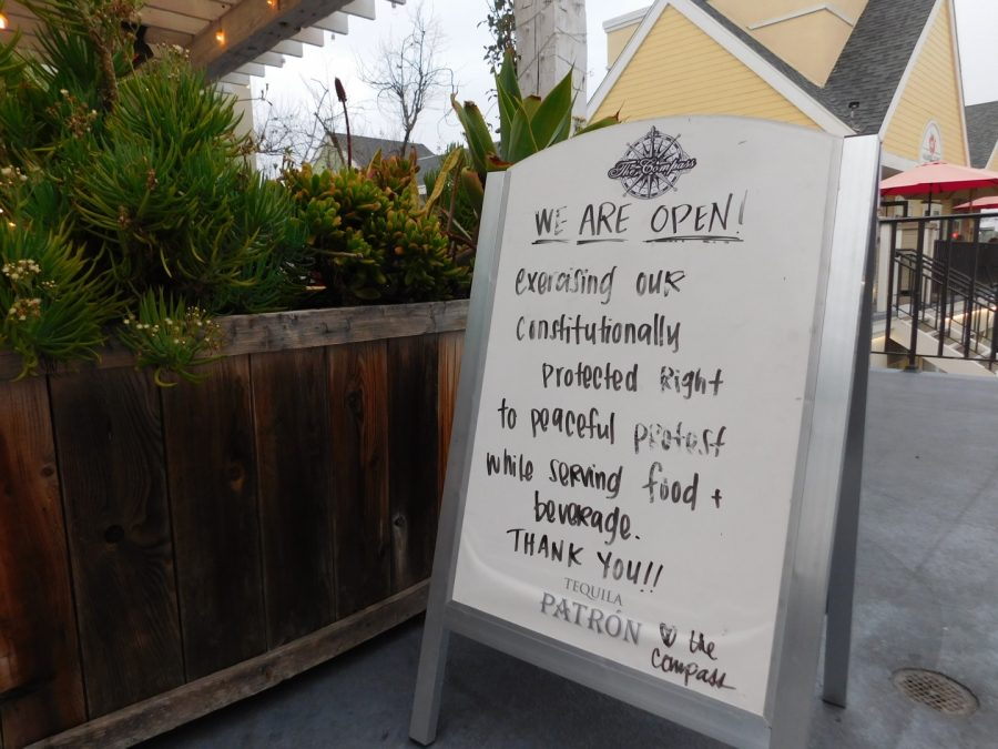 "A restaurant in the Carlsbad Village displays a sign noting their ""constitutionally protected right to peacefully protest while serving food and beverage."" Many restaurants in the Village have stayed open amidst state shutdown orders in an effort to save their business and the jobs of their employees."