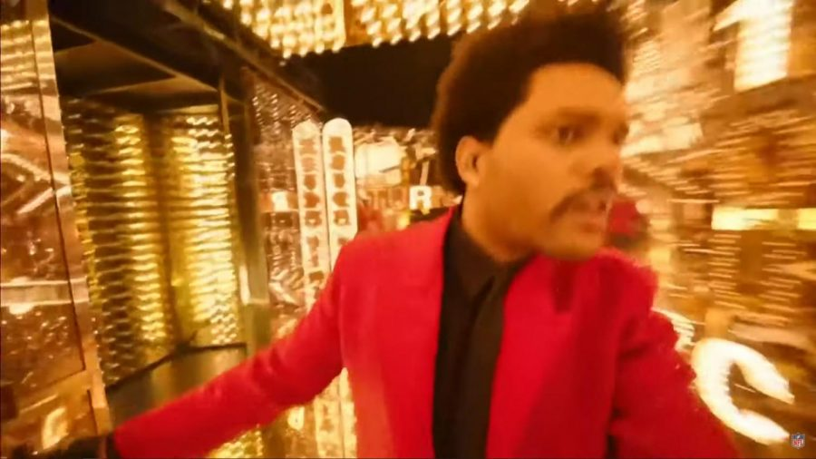 """The moment during The Weeknd's halftime show where he transitions songs from """"The Hills"""" to """"Can't Feel My Face."""" He made his way from the outside stage to an inside area full of mirrors and lights while carrying the camera himself. This moment has become an overnight meme, with legendary captions such as """"Me at The SuperMarket looking for my mom."""""""