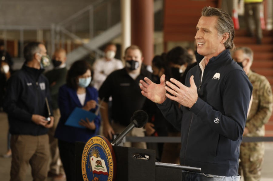 Pictured at a vaccination site, California's governor, Gavin Newsom announces that he and legislators have agreed upon a stimulus package for Covid-19. The distribution of the Covid relief package however, is going to those who need it most first and then forth throughout the legible groups that can receive the stimulus check.