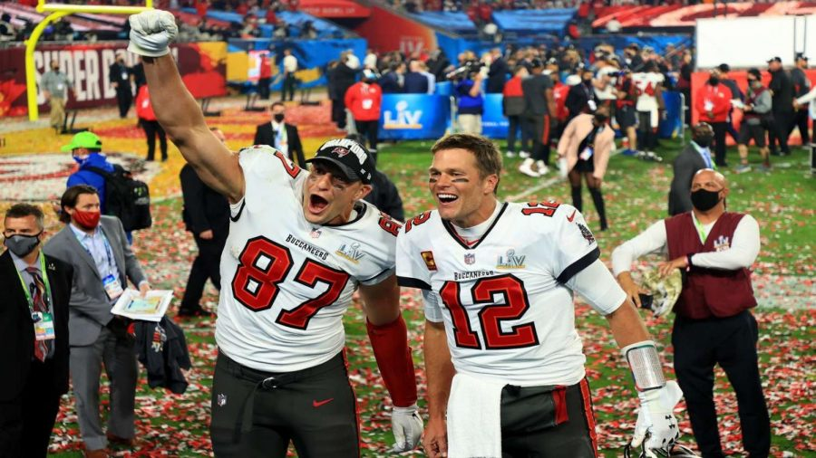 The Buccaneers celebrate taking the win at Super Bowl LV, making Tom Brady's seventh Super Bowl win. The Buccaneers celebrated their triumph over the Chiefs, bringing the final score to 31-9.