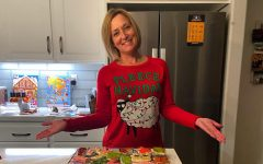 Jill Roth stands with a freshly completed batch of sugar cookies. Her fun-loving character shines through everything she does.