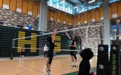 Sophomore Aaron Speirs goes up for a block.  With limited gym space Varsity, JV and Frosh teams have to practice all together.