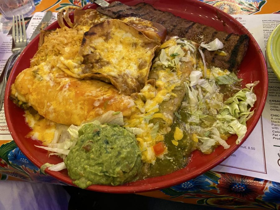 """Casa de Bandini's dishes up their """"Macho Grande"""" Chef's sampling plate for a family. Customers enjoy their meals in the colorful, inviting dining room."""