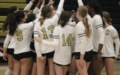 The girls volleyball team celebrates a 3-0 win at their home game against Escondido High School. They have won all but one of their home games so far this season.