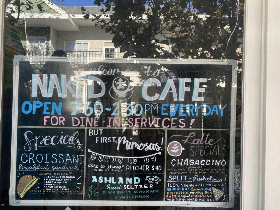 The Naked Cafe menu is on display, showing their specialization in mouthwatering breakfast and lunch food. They are open from 7:30 to 2:30 each day and they are ready to welcome you into their restaurant!