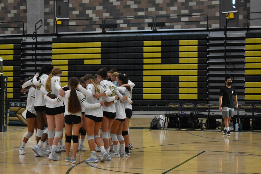 Members of the volleyball team hug before their game against Torrey Pines. The team was defeated three sets to zero.