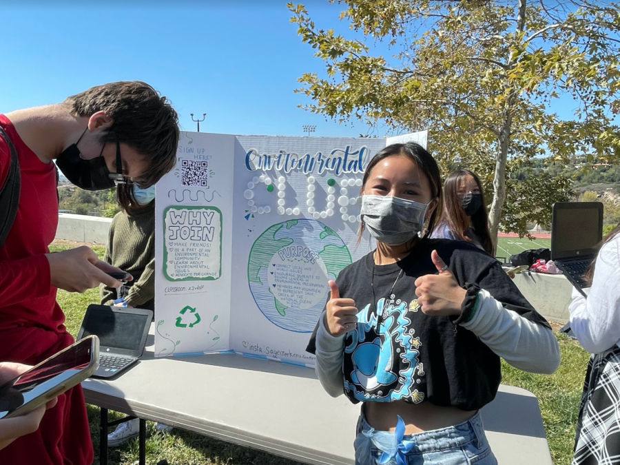 Environmental club leader, Aria Phan, poses with two thumbs up. Environmental club will be holding volunteer opportunities that help the environment for Sage Creek students.