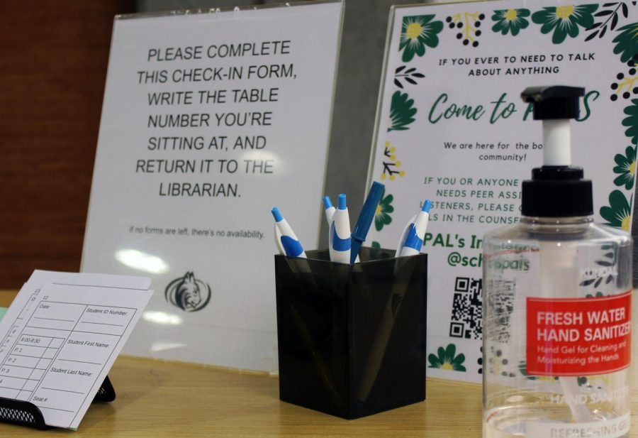 A sign-in station awaits visitors at the entrance of the library with hand sanitizer at hand. The library developed a system that would aid the process of contact tracing.